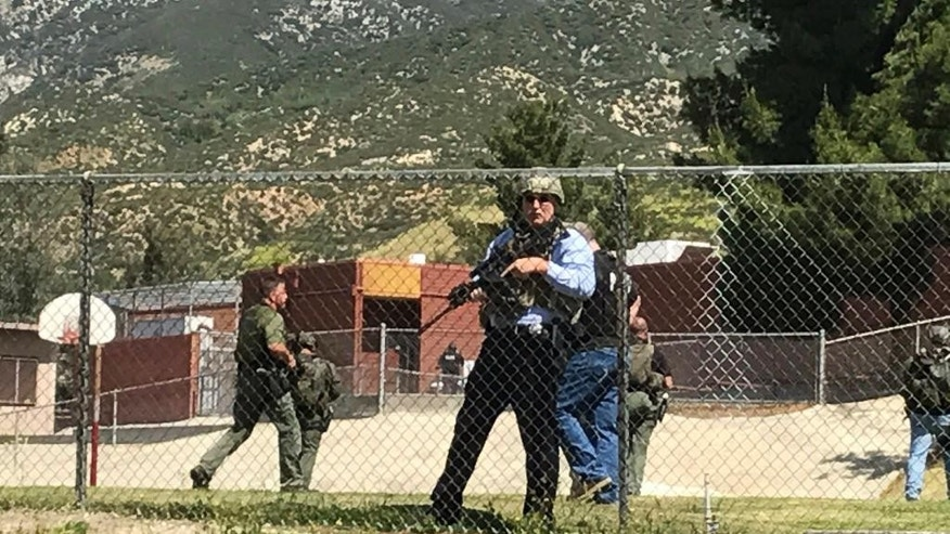 Emergency personnel respond to a shooting inside North Park Elementary School on Monday, April 10, 2017, in San Bernardino, Calif. (Rick Sforza/Los Angeles Daily News via AP)