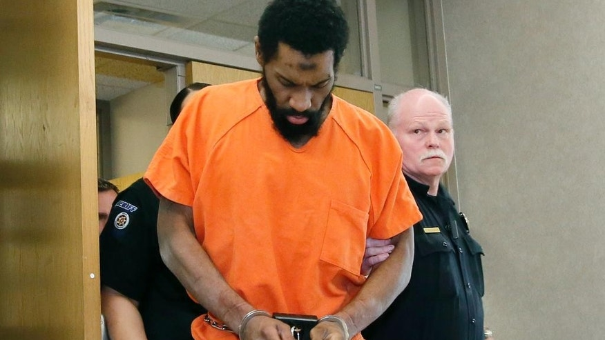 Defendant Alton Nolen, accused of beheading co-worker Colleen Hufford in September, 2014, is escorted from a courtroom in Norman, Okla., Tuesday, April 11, 2017. Cleveland County District Judge Lori Walkley has ordered the case to go to a jury trial. (AP Photo/Sue Ogrocki)