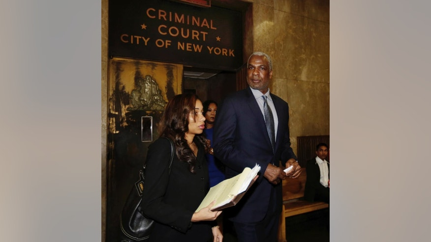 Former NBA enforcer and rebounding machine for the New York Knicks Charles Oakley leaves Manhattan Criminal Court, in New York, Tuesday, April 11, 2017. Oakley was charged with three counts of misdemeanor assault and one count of criminal trespass during an incident at Madison Square Garden. He is accused of striking one security guard in the face with a closed fist, and when two other people tried to intervene, both were pushed and received cuts.(AP Photo/Richard Drew)