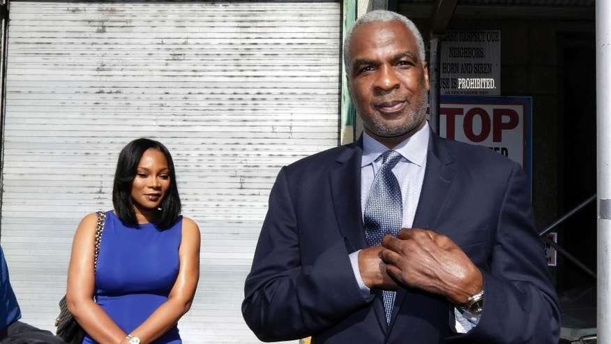 Former NBA enforcer and rebounding machine for the New York Knicks Charles Oakley, and his wife, Angela Reed, leave Manhattan Criminal Court, in New York, Tuesday, April 11, 2017. Oakley was charged with three counts of misdemeanor assault and one count of criminal trespass during an incident at Madison Square Garden. He is accused of striking one security guard in the face with a closed fist, and when two other people tried to intervene, both were pushed and received cuts.(AP Photo/Richard Drew)