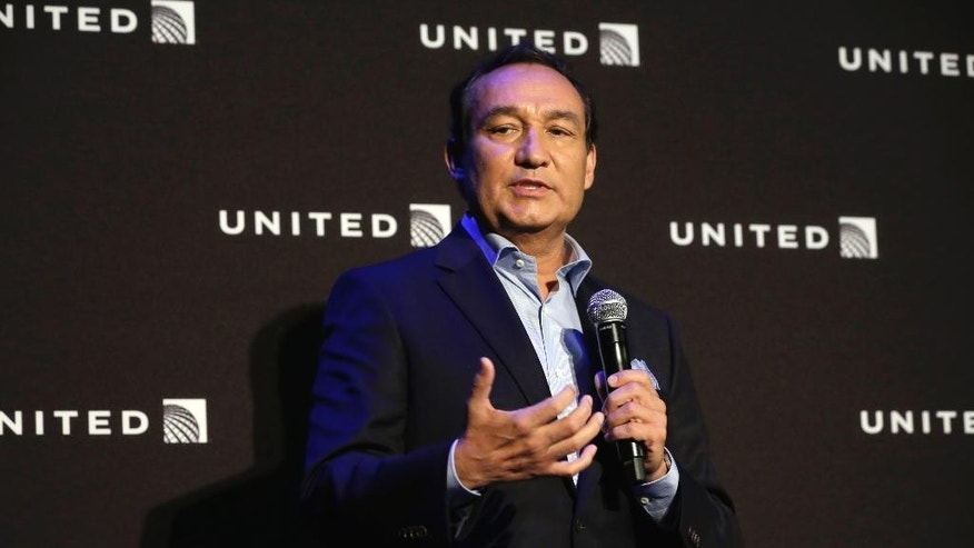 FILE- In this June 2, 2016, file photo, United Airlines CEO Oscar Munoz delivers remarks in New York, during a presentation of the carrier's new Polaris service. Video of police officers dragging a passenger from an overbooked United Airlines flight sparked an uproar Monday, April 10, 2017, on social media, but United's CEO defended his employees, saying they followed proper procedures and had no choice but to call authorities and remove the man. (AP Photo/Richard Drew, File)