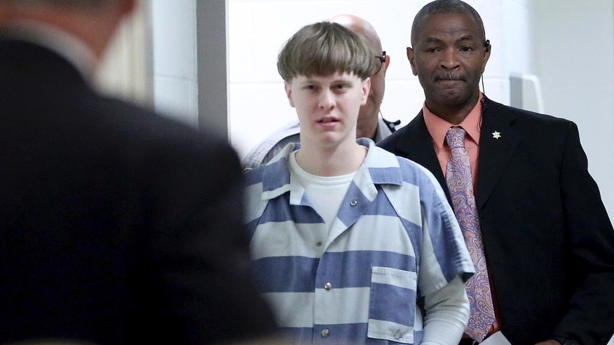 Dylann Roof enters the court room at the Charleston County Judicial Center Monday, April 10, 2017, to enter his guilty plea on murder charges in Charleston, S.C.  The convicted Charleston church shooter, Roof was given nine consecutive life sentences in state prison after he pleaded guilty to state murder charges Monday, leaving him to await execution in a federal prison and sparing his victims and their families the burden of a second trial. (Grace Beahm/The Post And Courier via AP, Pool)