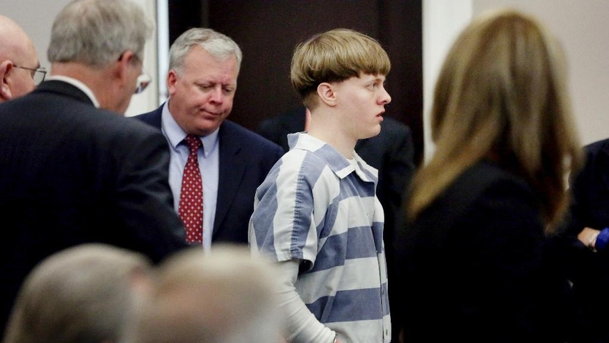 Dylann Roof enters the court room at the Charleston County Judicial Center Monday, April 10, 2017 to enter his guilty plea on murder charges in Charleston,S.C.  The convicted Charleston church shooter, Roof was given nine consecutive life sentences in state prison after he pleaded guilty to state murder charges Monday, leaving him to await execution in a federal prison and sparing his victims and their families the burden of a second trial. (Grace Beahm/The Post And Courier via AP, Pool)