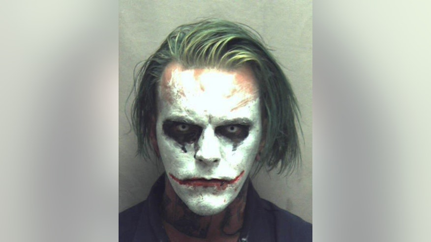 This photo provided by the Winchester Police Department shows Jeremy Putman, who police in Winchester, Va., arrested Friday, March 24, 2017, after callers reported seeing him walking, wearing a cape, carrying a sword and made up as the Batman villain the Joker. Authorities charged Putman with wearing a mask in public, a felony that can result in a sentence of a year in jail. (Winchester Police Department via AP)