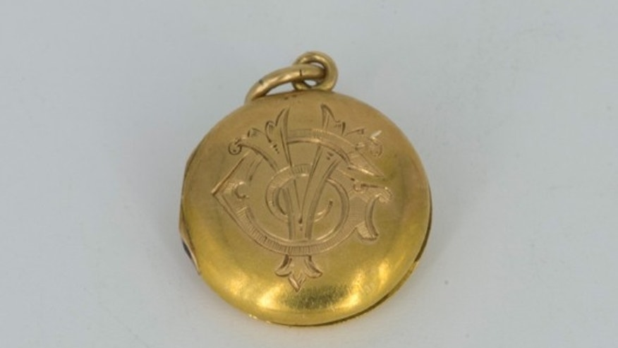 Gold locket belonging to RMS Titanic survivor Virginia Estelle McDowell Clark.