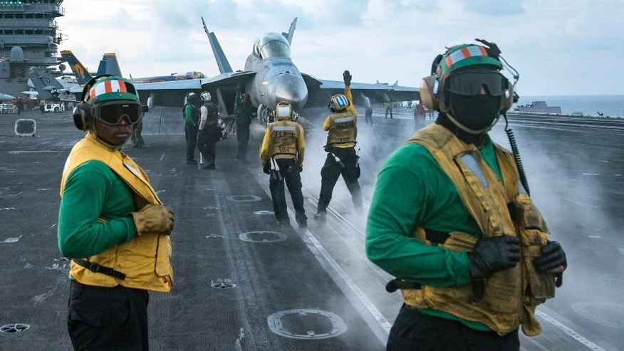 In this photo provided by the U.S. Navy, sailors conduct flight operations on the aircraft carrier USS Carl Vinson (CVN 70) flight deck in April 8, 2017.  The Trump administration deployed an aircraft carrier to the region this week in a show of force that also could expose American weakness. If the North proceeds with a ballistic missile or nuclear test and the U.S. does nothing in response, America's deterrence will appear diminished. The USS Carl Vinson is steaming to waters off the Korean Peninsula as anticipation mounts that Kim Jong Un will stage another weapons test around the anniversary of the nation's founder on Saturday.(Mass Communication Specialist 3rd Class Matt Brown/U.S. Navy via AP)