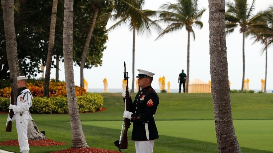 FILE - In this April 6, 2017 file photo, military personnel stand for the arrival of Chinese President Xi Jinping and his wife Chinese first lady Peng Liyuan at Mar-a-Lago in Palm Beach, Fla. to meet with President Donald Trump and first lady Melania Trump. It's widely estimated that each trip to the resort costs taxpayers $3 million, based on a government study of the cost of a 2013 trip to Florida by President Barack Obama. But that trip was more complicated and the study's author says it can't be used to calculate the cost of Trump's travel. This weekend, Trump is making his seventh visit to Mar-a-Lago since becoming president.  (AP Photo/Alex Brandon, File)
