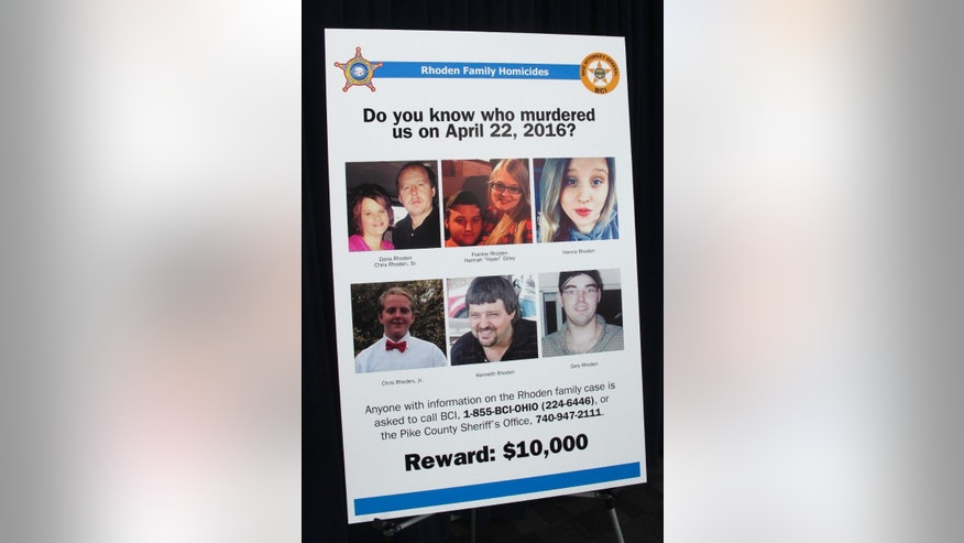 A poster asking for information about the unsolved killings of eight family members in southern Ohio on April 22, 2016, is displayed at the Ohio Attorney General's Office during a press conference on Thursday, April 13, 2017, in Columbus Ohio (AP Photo/Andrew Welsh-Huggins)