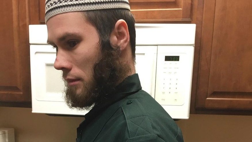 Abdullah Rashid, 22, a Georgia native who moved to Cedar-Riverside last year, says his group, General Presidency of the Religious Affairs and Welfare of the Ummah, is trying to enforce what he calls 'the civil part of the sharia law' in the area. Muslim leaders in Minneapolis are wary of Rashid, who has been patrolling a predominantly Somali neighborhood to enforce the Islamic civil code.  (Faiza Mahamud/Star Tribune via AP)