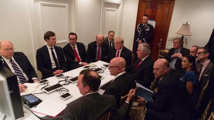 "In this image provided by the White House, taken April 6, 2017, Deputy National Security Adviser Dina Powell, right,  joins President Donald Trump, and others, as he receives a briefing on the Syria military strike from his National Security team after the strike at Mar-a-Lago in Palm Beach, Fla. In a White House split between outsider ideologues and more traditional operators, Powell is viewed as a steady force in the growing influence of the latter. A newer addition to the team, her West Wing experience, conservative background and policy chops have won over Trump's daughter and son-in-law. Now, as the president turns his attention to international affairs, attempting to craft a foreign policy out of a self-described ""flexible"" approach to the world, Powell is at the table. (White House via AP)"