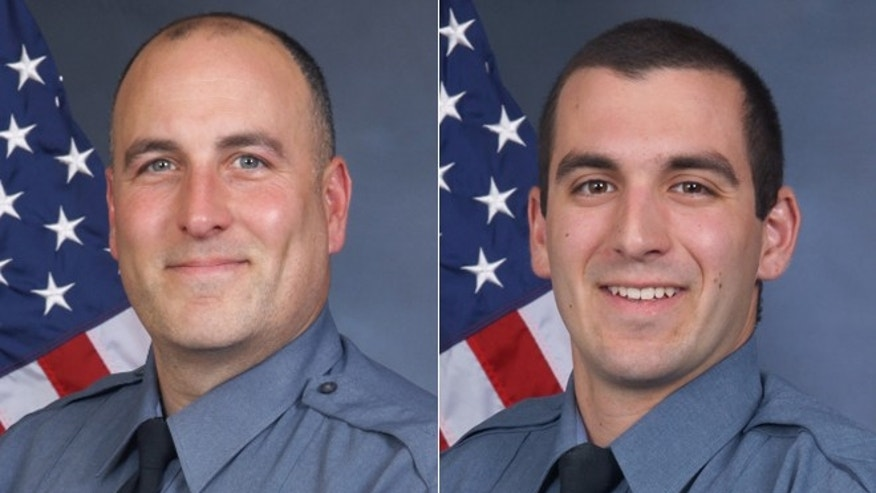 Michael Bongiovanni (left) and Robert McDonald (right) were fired Thursday after video showed them assaulting a man during a traffic stop in Georgia.