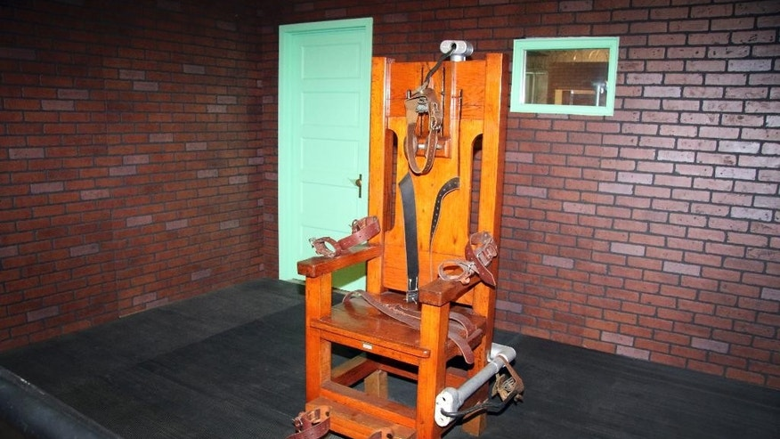 In this April 5, 2017 photo, an exhibit at the Texas Prison Museum shows the old Texas electric chair used to execute hundred of Texas inmates in Huntsville, Texas, from 1924 through 1964. In Texas, records show multiple executions 28 times starting in 1924 when the state took over execution duties from counties and electrocution became the capital punishment method. For its inauguration on Feb. 8, 1924, the new electric chair was used five times. Arkansas is set to use lethal injection for a scheduled seven executions, two of which are planned for Monday, April 17. (AP Photo/Michael Graczyk)