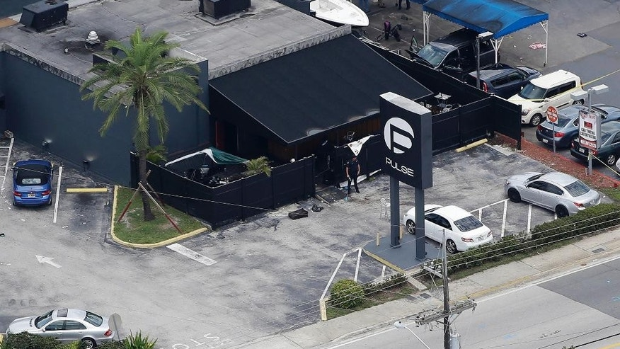 June 12, 2016: Law enforcement officials work at the Pulse nightclub in Orlando, Fla., following a mass shooting.