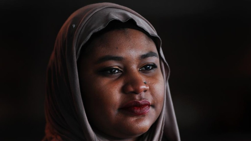 Fatimah Farooq is shown, Tuesday, March 14, 2017 in Ann Arbor, Mich. Farooq counsels refugees from places like Iraq and Syria, who have been victims of trauma, torture or sex trafficking. Personally, she tries to help relatives from Sudan, some of whom have faced barriers resettling in the United States as her parents did right before she was born. In between, she is trying to navigate being black, Muslim and a daughter of immigrants.(AP Photo/Paul Sancya)