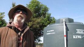 In this photo taken April 10, 2017, is David Miguel at his home in the community of Hardwick in the San Joaquin Valley where drought has yet to loosen its grip on some residents near Hanford, Calif. State officials lifted the drought emergency for much California, but thousands of people like Miguel still live on water tanks because their wells ran dry. (AP Photo/Scott Smith)