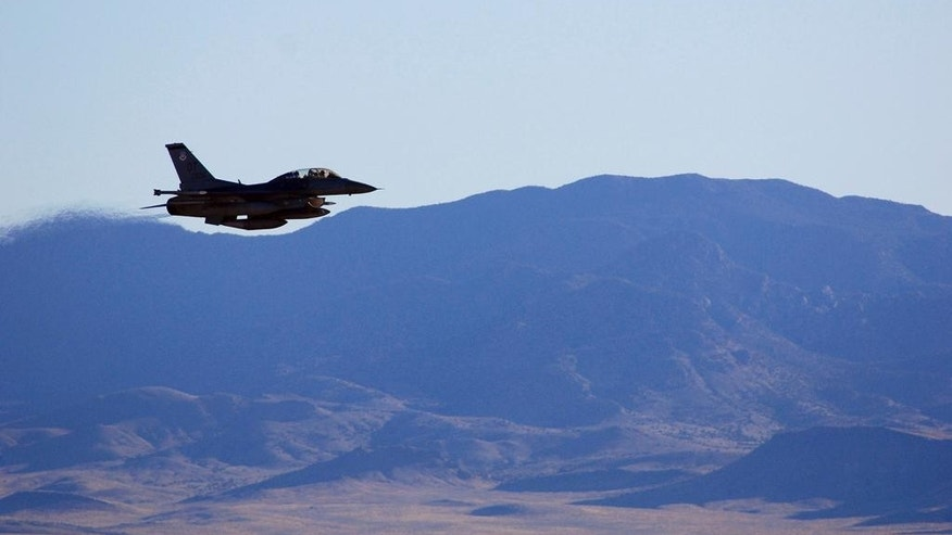 In this March, 2017, photo supplied by Sandia National Laboratories, an F-16C makes a pass over Nevada's Tonopah Test Range after a March test of a mock nuclear weapon as part of a life extension program for the B61-12, near Tonopah, Nev. Scientists at Sandia National Laboratories are claiming success with the first in a new series of test flights that are part of an effort to upgrade one of the nuclear weapons that has been in the U.S. arsenal for decades. (John Salois/Sandia National Laboratories via AP)