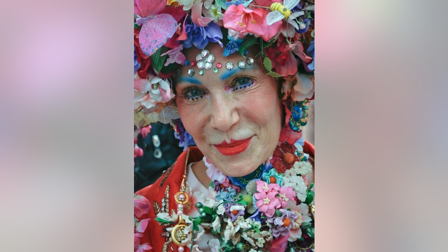 "Patricia ""Purely"" Fox, of Manhattan, shows off her Easter bonnet that she said took 20 hours to make at the annual Easter Parade and Bonnet Festival, Sunday, April 16, 2017, in New York. (AP Photo/Bebeto Matthews)"