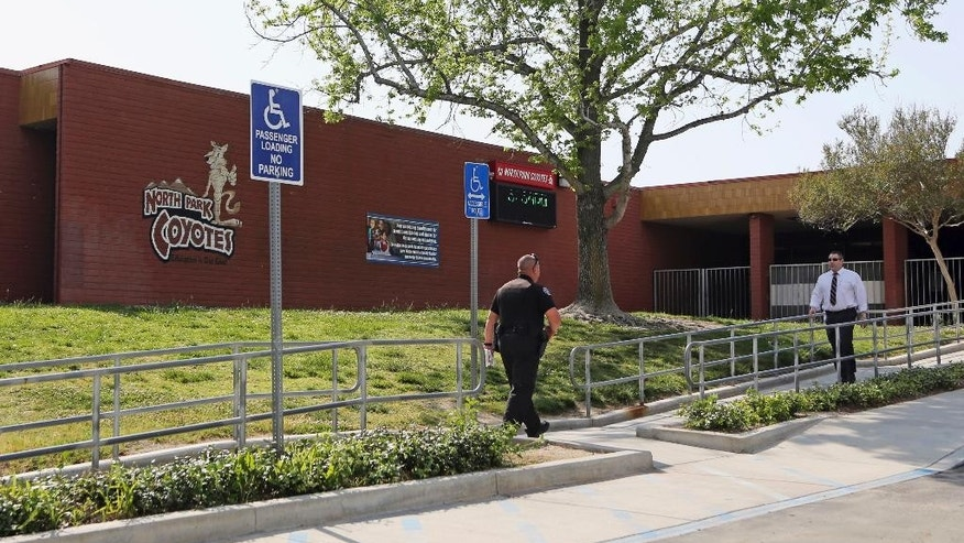 This Tuesday, April 11, 2017 photo shows the entrance to North Park Elementary School in San Bernardino, Calif., following the shooting death of a teacher and a student on Monday. Classes are scheduled to resume Monday, April 17, with additional personnel and crisis counselors on hand to help students who may need support. The school will also have enhanced security procedures. (AP Photo/Reed Saxon)