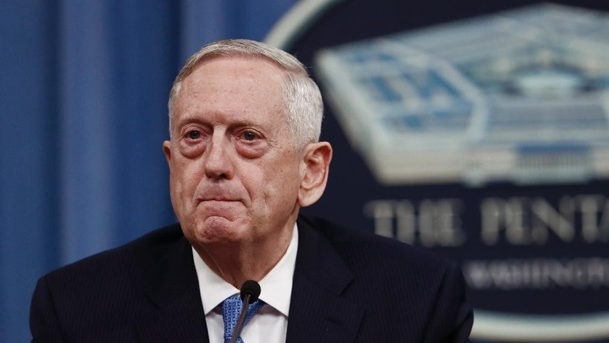 FILE - In this April 11, 2017 file photo, Defense Secretary Jim Mattis pauses during a news conference at the Pentagon. Mattis is looking to the Middle East and North Africa for broader contributions and new ideas to fight Islamic extremism as the Trump administration fleshes out its counterterrorism strategy. His trip to the region this week includes stops with longstanding allies Israel and Saudi Arabia, and new partners like Djibouti.  (AP Photo/Carolyn Kaster, File)