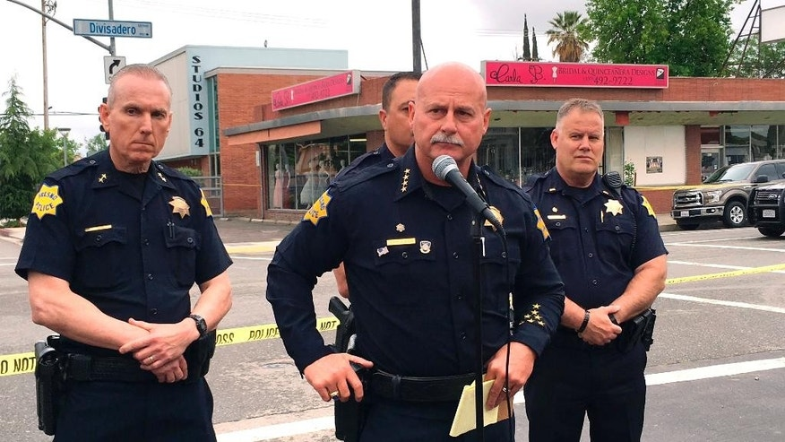 "Fresno police chief Jerry Dyer, front, briefs reporters in Fresno, Calif., after a shooting Tuesday, April 18, 2017. A man shot and killed three people on the streets of downtown Fresno shouting ""God is great"" in Arabic during at least one of the slayings and later telling police that he hates white people, authorities said. (AP Photo/Scott Smith)"