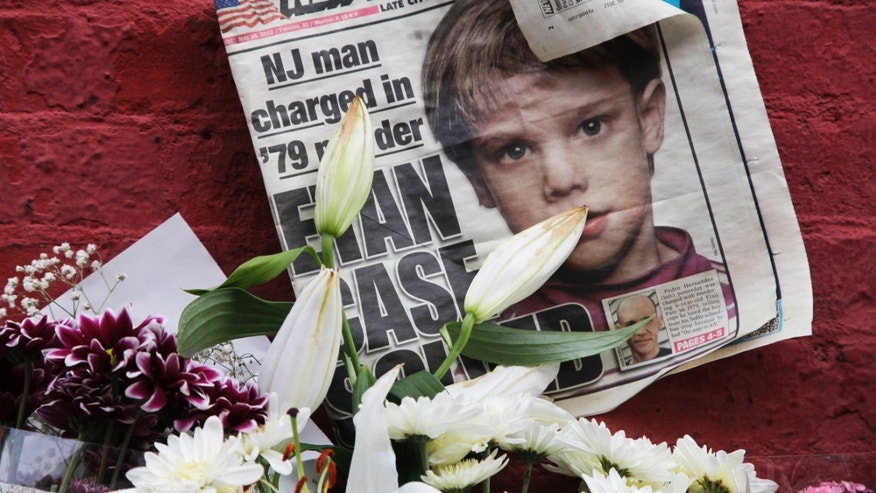 This May 28, 2012, file photo shows a newspaper with a photograph of Etan Patz at a makeshift memorial in the SoHo neighborhood of New York where Patz lived before his disappearance on May 25, 1979.