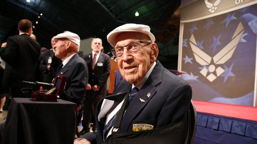 "FILE – In this April 18, 2015, file photo, two members of the Doolittle Tokyo Raiders, retired U.S. Air Force Lt. Col. Richard ""Dick"" Cole, seated front, and retired Staff Sgt. David Thatcher, seated left, pose for photos after the presentation of a Congressional Gold Medal honoring the Doolittle Tokyo Raiders at the National Museum of the U.S. Air Force at Wright-Patterson Air Force Base in Dayton, Ohio. Cole, co-pilot of the Doolittle Tokyo Raiders' lead plane and a fly-over by vintage B-25 bombers will be part of Ohio events April 17-18, 2017 for the 75th anniversary of the daring attack that helped turn the tide of World War II. Cole said it will be a somber moment when he toasts fellow Raider, Thatcher, who died in 2016. (AP Photo/Gary Landers, File)"