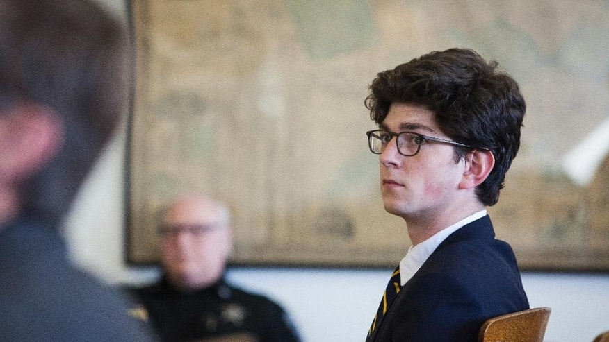 FILE- In this Feb. 23, 2017, file photo, Owen Labrie listens to testimony during the last day of an evidentiary hearing on whether he will be granted a retrial at Merrimack County Superior Court in Concord, N.H. Labrie, a New Hampshire prep school graduate convicted of sexually assaulting a classmate, was denied a new trial Wednesday, April 19, by a judge who called some of his claims of ineffective counsel absurd and almost frivolous. (Elizabeth Frantz/The Concord Monitor via AP, Pool, File)