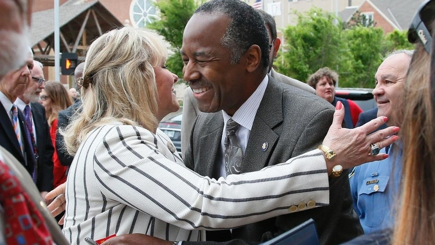Oklahoma Gov. Mary Fallin, left, greets Housing and Urban Development Ben Carson, M.D., right, before the start of the 22nd Anniversary Remembrance Ceremony of the Oklahoma City bombing in Oklahoma City, Wednesday, April 19, 2017. Carson is speaking at the ceremony. (AP Photo/Sue Ogrocki)