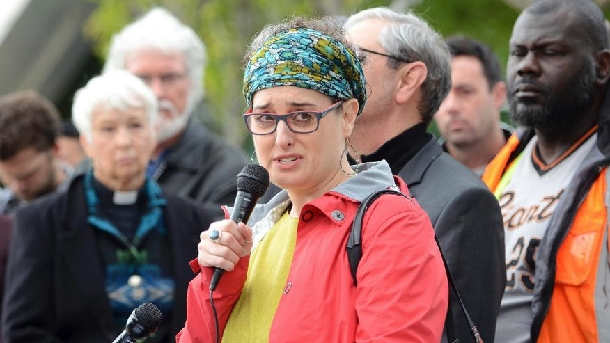 Rabbi Laura Novak Winer, of Temple Beth Israel, speaks out against violence and asks the people of Fresno to educate themselves about Islam at a gathering of faith leaders in response to a shooting that killed 3 people in downtown Fresno, Calif., on Tuesday, April 18, 2017. A man wanted in the slaying of a security guard set out to kill as many white people as he could on Tuesday, gunning down three men on the streets of downtown Fresno before he was captured and admitted to the shootings, authorities said. (Silvia Flores/The Fresno Bee via AP)