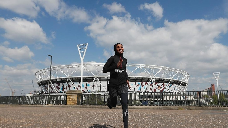 Somalian athlete Zamzam Farah runs near the London Stadium in London, Wednesday, April 19, 2017. Farah who sought asylum in London after competing in the 2012 Olympics will be back running in the British capital in Sunday's marathon. Zamzam Farah started a new life in London after receiving online death threats from Islamist extremist group al-Shabab during the Olympics in August 2012  (AP Photo/Kirsty Wigglesworth)