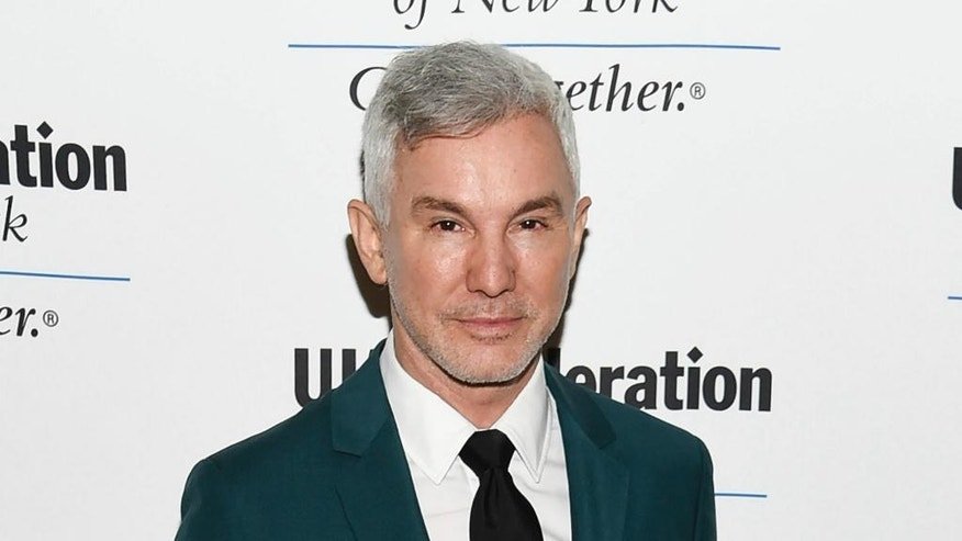 "FILE - In this June 16, 2016 file photo, director Baz Luhrmann attends the UJA-Federation of New York's ""Music Visionary of the Year Award"" luncheon in New York. ""Moulin Rouge"" director Luhrmann will speak to graduating seniors at Princeton. Princeton's graduating class chose him as their Class Day speaker next month. The Australian will address graduates and their guests the day before commencement. (Photo by Evan Agostini/Invision/AP, File)"