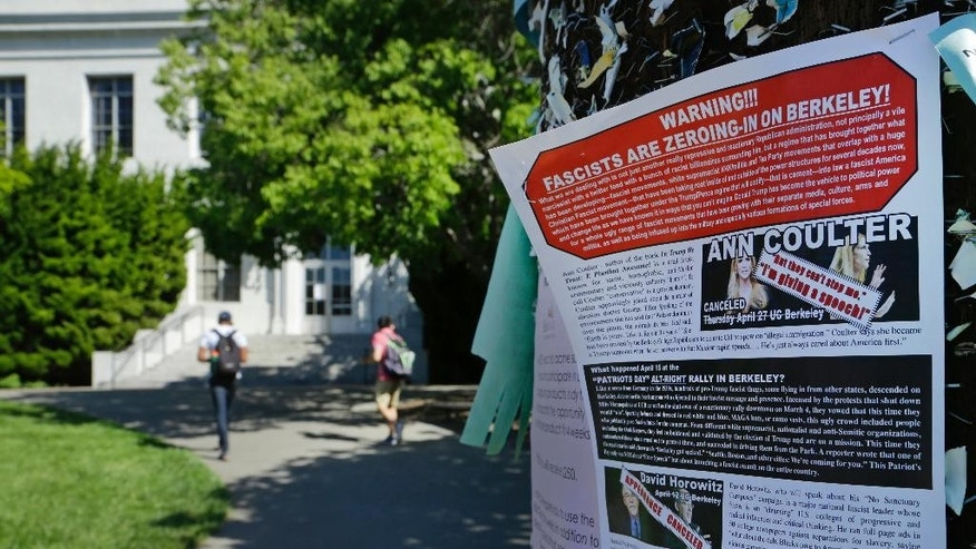 "A leaflet is seen stapled to a message board near Sproul Hall on the University of California at Berkeley on Friday, April 21, 2017, in Berkeley, Calif. The campus is bracing for a showdown next week, when the conservative provocateur Ann Coulter has vowed to speak in defiance of the university's wishes. Officials, police and the campus Republicans who invited Coulter, say there are valid concerns for violence in what is being called an ongoing ""Battle of Berkeley."" (AP Photo/Ben Margot)"