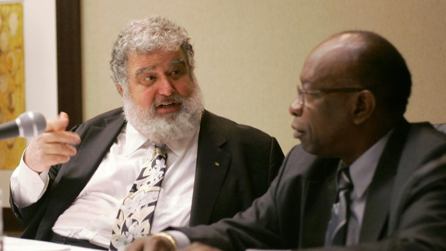 FILE - In this Jan. 28, 2008, file photo, CONCACAF General Secretary Chuck Blazer, left, and President Jack Warner chat during a news conference in Miami.  In papers filed earlier this week in federal court in Brooklyn, N.Y., the Confederation of North, Central American and Caribbean Association Football accuses the two former FIFA officials of making a fortune through embezzlement, allegations that mirror those in a sprawling U.S. criminal investigation that has resulted in charges against several top soccer officials. The suit accuses the pair of negotiating bribes and kickbacks in connection with lucrative broadcasting rights for tournaments including CONCACAF's Gold Cup championship. AP Photo/Wilfredo Lee, File)