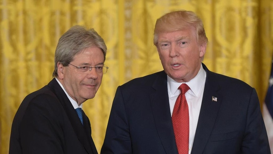 President Donald Trump, right, shakes hands with Italian Prime Minister Paolo Gentiloni, left, following their news conference in the East Room of the White House in Washington, Thursday, April 20, 2017. (AP Photo/Susan Walsh)