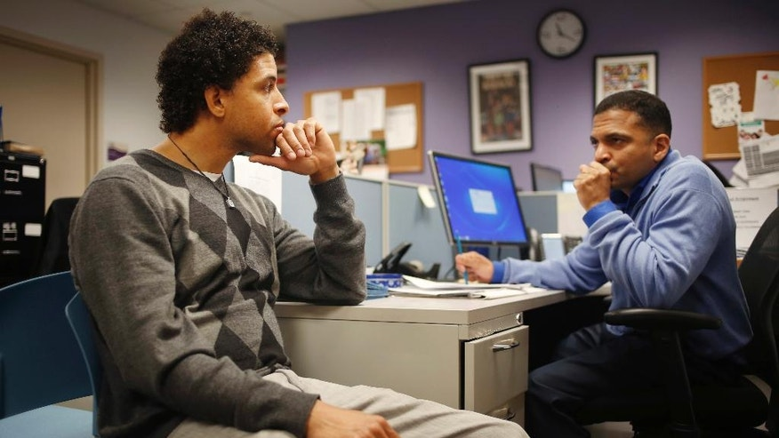 "In this Thursday, April 20, 2017 photo, Neftali Thomas Diaz, left, talks with his case manager, David Rodriguez, at The Fortune Society in New York. New York City is betting that Diaz and other low-level offenders like him are right about the salvation in second-chance employment. Mayor Bill de Blasio said the city will spend $10 million a year on a ""jails to jobs"" initiative that will guarantee all Rikers inmates serving sentences of a year or less a chance at short-term employment once they do their time. (AP Photo/Seth Wenig)"