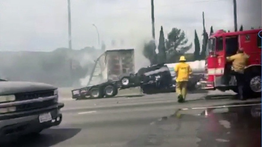 Firefighters respond to a deadly crash on Interstate 5 in Los Angeles Tuesday, April 25, 2017.