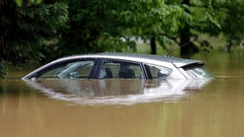 A car is submerged in floodwater along Glenwood Avenue in Raleigh, N.C., Tuesday, April 25, 2017. Storms have dumped several inches of rain on North Carolina's capital, prompting firefighters to rescue people from their vehicles and delaying school bus schedules. (AP Photo/Gerry Broome)