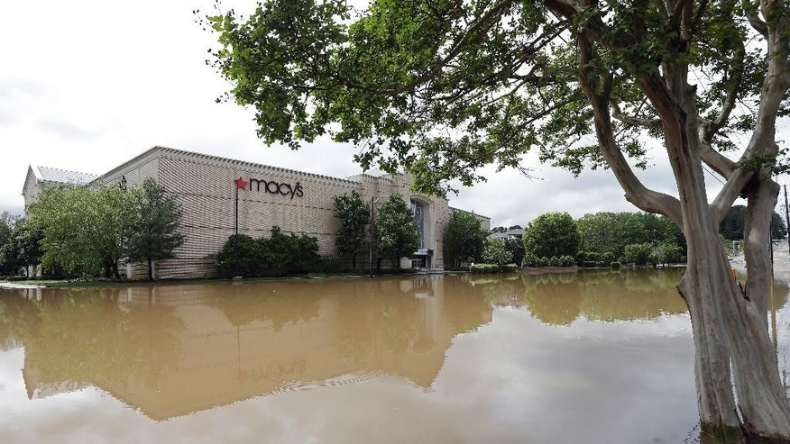 Floodwater fills the parking lot of Macy's at Crabtree Valley Mall in Raleigh, N.C., Tuesday, April 25, 2017.