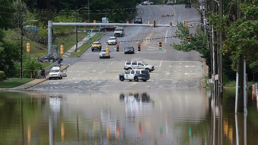 Police block a flooded Creedmoor Road in Raleigh, N.C., Tuesday, April 25, 2017.