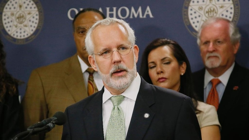 Former Oklahoma Gov. Brad Henry gestures as he answers a question during a news conference in Oklahoma City, Tuesday, April 25, 2017. Henry, one of the co-chairs of the Oklahoma Death Penalty Review Commission, announced the findings of a report that says the state should extend its moratorium on capital punishment. (AP Photo/Sue Ogrocki)