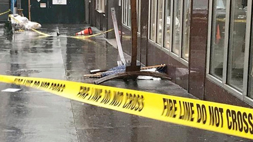 In this April 25, 2017 photo provided by ABC 7 Eyewitness News in New York, a wooden hammock lay on the sidewalk in New York.