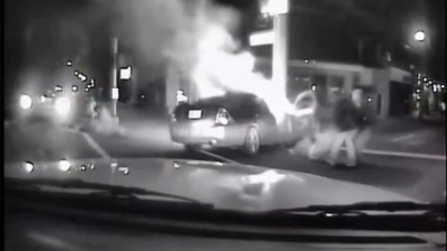 A Good Samaritan and a Louisville police officer saved two people from a burning car.