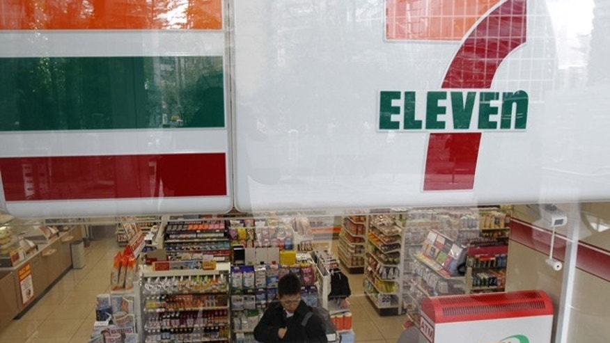 A customer is seen at a Seven-Eleven convenience store in Tokyo December 22, 2010.