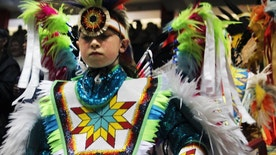 FILE--In this April 29, 2016, file photo, nearly 3,000 indigenous dancers from across the United States and other countries participate in the first grand entry of the 33rd annual Gathering of Nations in Albuquerque, N.M. The Gathering of Nations is set to begin Thursday, April 27, 2017, at Expo New Mexico after the organization parted ways in a public spat with its longtime host at the University of New Mexico's basketball arena. (AP Photo/Susan Montoya Bryan, file)