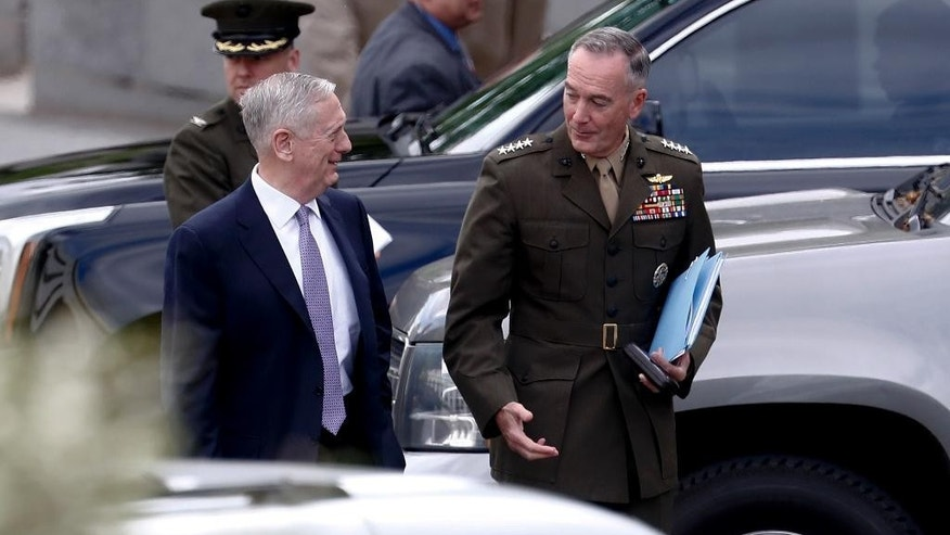 Defense Secretary Jim Mattis and Joint Chiefs Chairman Gen. Joseph Dunford talks as they walk from an all Senators briefing on the situation in the Koreas, Wednesday, April 26, 2017, at the Eisenhower Executive Office Building on the White House complex in Washington. (AP Photo/Carolyn Kaster)