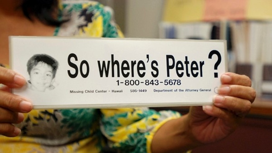 "File - This June 6, 2016 file photo taken in Honolulu shows a bumper sticker Hawaii officials distributed in a campaign for a Hawaii boy who disappeared 20 years ago. The child, known as ""Peter Boy,"" became the face of missing and abused children in the late 1990s and early 2000s. The father of a Hawaii boy who went missing 20 years ago has led police to the site Sunday, April 23, 2017, where he disposed his son's remains. Peter Kema Sr. is providing information about the location of the boy's body as part of a plea deal reached earlier this month. (AP Photo/Jennifer Sinco Kelleher, File)"
