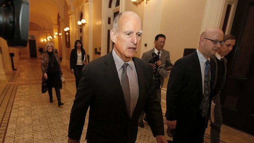 FILE - In this April 6, 2017, file photo, California Gov. Jerry Brown returns to his office after a meeting in Sacramento, Calif. Brown and the California Legislature are among this year's winners of the Jefferson Muzzles, satiric awards bestowed by a free speech group for what it considers egregious offenses. Brown and legislators passed a law banning online employment databases from listing the ages of actors and actresses. The Charlottesville, Va.-based Thomas Jefferson Center for the Protection of Free Expression announced its awards Thursday, April 27, 2017. (AP Photo/Rich Pedroncelli, File)