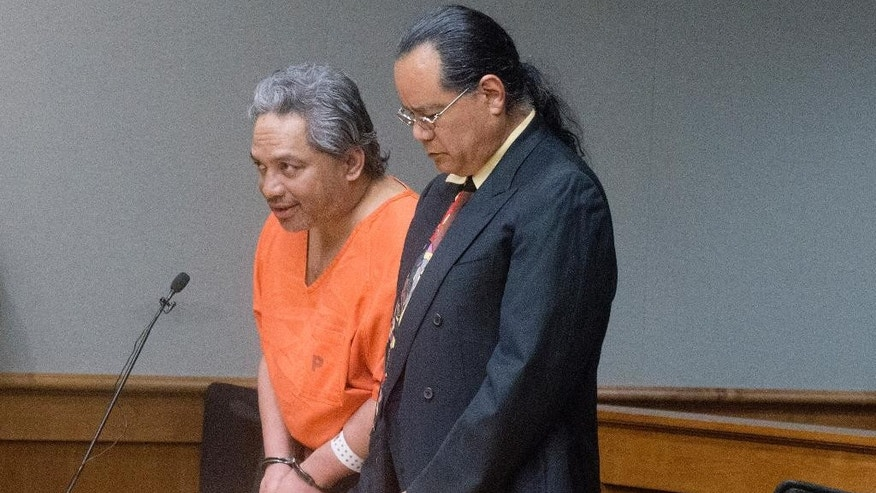 "FILE - In this April 5, 2017 file photo, Peter Kema Sr., left, pleads guilty to manslaughter and first-degree hindering prosecution in the death of his son, Peter Kema Jr., also known as ""Peter Boy,"" who went missing in 1997, in Hilo Circuit Court in Hilo, Hawaii. The father of the Hawaii boy who went missing 20 years ago has led police to the site where he disposed his son's remains.  Kema Sr. is providing information about the location of the boy's body as part of a plea deal reached earlier this month. (Hollyn Johnson/Hawaii Tribune-Herald via AP, Pool, File)"