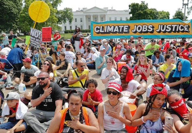 Climate March: Tens of thousands protest Trump climate policies, demand environmental action