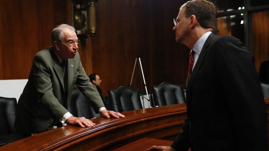 Senate Judiciary Committee Chairman Sen. Charles Grassley, R-Iowa, left, talks with Eric Treene, Special Counsel For Religious Discrimination, Civil Rights Division of the Justice Department, on Capitol Hill in Washington, Tuesday, May 2, 2017, before Treene testified before the committee's hearing on responses to the increase in religious hate crimes. (AP Photo/Carolyn Kaster)